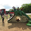 Staff photo by Cathy Spaulding<br /> Youngsters climb all over an alligator play structure at the Dr. Martin<br /> Luther King Jr. Community Center. The Center will have a gala Saturday to raise money for larger and safer structures.