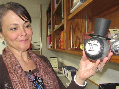 CATHY SPAULDING/Muskogee Phoenix Fort Gibson Advanced Placement teacher Cassandra Edwards holds a Lincoln-themed ornament a student made in class. Edwards was recently as District Teacher of the Year.