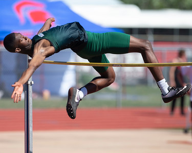 VON CASTOR/Phoenix Special Photo Muskogee's Kentrell Mitchum clears the high-jump bar Friday at Indian Bowl.