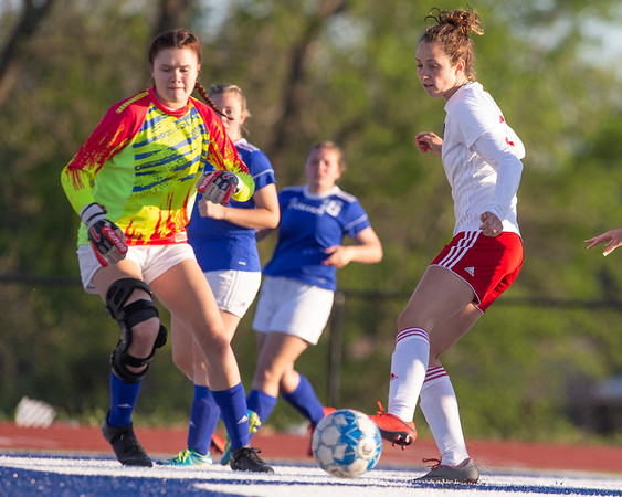 VON CASTOR/Phoenix Special Photo Fort Gibson's Zoey Whiteley slips a shot past Porter's goalkeeper Bailey Robertson Friday at Porter.