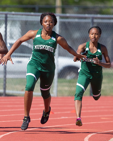 VON CASTOR/Phoenix Special Photo Jenee Coleman hands the baton to Lonnesha Hill in Muskogee's run of the 400-meter relay at Indian Bowl on Friday. Muskogee was second in the event.