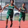 VON CASTOR/Phoenix Special Photo<br /> Jenee Coleman hands the baton to Lonnesha Hill in Muskogee's run of the 400-meter relay at Indian Bowl on Friday. Muskogee was second in the event.