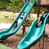 "Staff photo by Mark Hughes<br /> Eric Walters, 12, and his brother Jack, 9, enjoy the slides at the playground at Honor Heights Park on Wednesday. They were ""burning off energy"" after a dental appointment and lunch, their mother, Jamie, said."