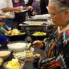 Special photo by Mike Elswick<br /> Sylvia Swan, right, a seven-year volunteer for the Muskogee Farmers Market, goes through the serving line prior to a volunteer awards presentation hosted by the city's Nonprofit Resource Center.