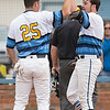 Phoenix special photo by Von Castor<br /> Oktaha's Dawson Hogner, left, greets Keith Jones at home plate after Jones hit a walk-off, two-run home run to run-rule Muldrow at Tiger Field in Oktaha.