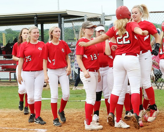 Phoenix special photo by John Hasler<br /> Fort Gibson's Aubree Bell (22) and Abby Scott chest-bump after one of Bell's three home runs Thursday.