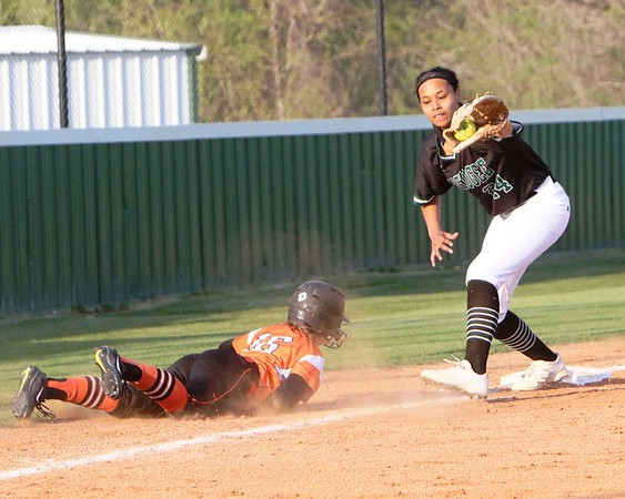 JOHN HASLER/Phoenix special photo<br /> Muskogee's Shania Henry catches Tahlequah's Alexa Cacy off the bag at third for an out. The Roughers beat<br /> Tahlequah and Fort Gibson in a three-way playoff tune-up at Roughers Park on Thursday.