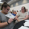CATHY SPAULDING/Muskogee Phoenix<br /> Muskogee High School senior Emilee Walters, left, and her mother, Diana Walters, admire a certificate Emilee received for volunteering through the MHS Rougher 300 program.
