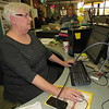CATHY SPAULDING/Muskogee Phoenix<br /> Retired Muskogee High School Librarian Jan Ward volunteers to help in her old surroundings two days a week. She said one person cannot do it alone.