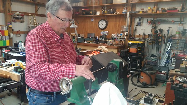 Robert Raley says he's learning how to use a wood lathe to craft woodworking items in his shop.