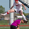 Fort Gibson's Jordan Raynor leaps over Hilldale goalkeeper Viktoria Diaz after attempting a shot that Diaz blocked Tuesday  at Leo Donnahue Stadium in Fort Gibson.