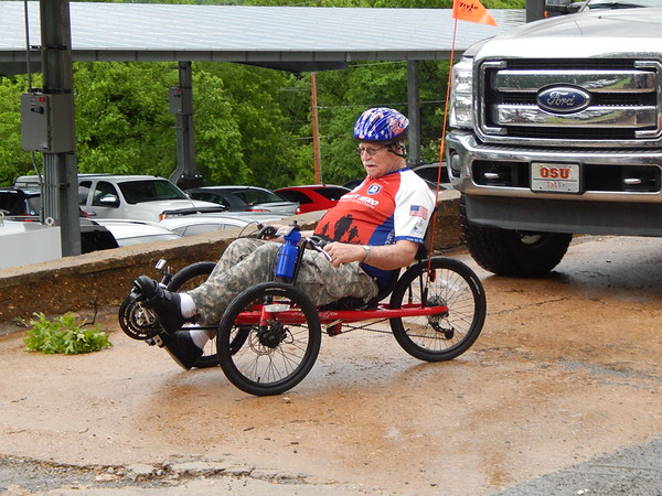 """Staff photo by Mark Hughes<br /> Vietnam veteran Dennis Adcock tries out his new Tadpole bicycle provided free by the Enid AM AMBUCS organization Friday. """"It just makes me feel great — I've waited about a year for it,"""" Adcock said. """"I can't tell you how appreciative we are to get these bikes."""" AMBUCS donated a total of 12 bikes. Veterans will ride these bikes as part of their therapy and integration back into the community."""