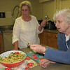 CATHY SPAULDING/Muskogee Phoenix<br /> St. Joseph Catholic Church Altar Society members Margaret Kymes, left, and Joan Pierret sample a lawn mower salad<br /> prepared by Pat Self. The Altar Society will have its annual Quiche and Salad Luncheon on Thursday.