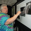 CATHY SPAULDING/Muskogee Phoenix<br /> Polly Moore shows details of her scratchboard art work.