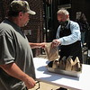 CATHY SPAULDING/Muskogee Phoenix<br /> Gospel Rescue Mission guest Michael Scobee, right, hands a sack lunch to Travis Robison shortly after noon Tuesday. The mission offers a soup kitchen noon to 12:30 p.m.
