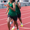 Phoenix special photo by Shane Keeter<br /> Lady Roughers Zomaree McNac, right, hands the baton forward to Shauna Logan in the 2nd handoff of the 400m relay during the Sprocket Track Classic.