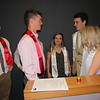 CATHY SPAULDING/Muskogee Phoenix<br /> Fort Gibson High School Red Scholars, from left, Connor Landers and Blake Faulkner visit with White Scholars, Gracie Bradham, center and Larry Crooks during the Red and White Scholars Banquet.