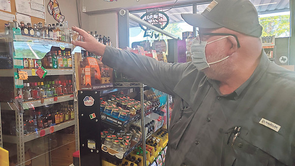CHESLEY OXENDINE/Muskogee Phoenix<br /> Jerry Hukill of USA Liquor discusses his inventory amid the COVID-19 pandemic.