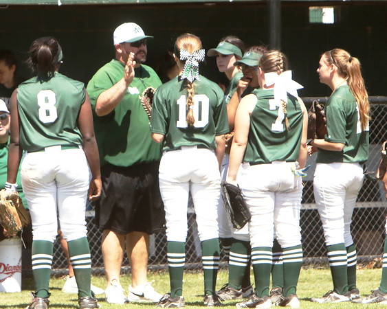 Special photo by John Hasler<br /> Muskogee softball coach Keith Coleman, second from left, congratulates his players coming into the dugout. The longtime coach and teacher at Muskogee High School is entering the final stages at the helm of his alma mater. Coleman is moving to Piedmont next fall to be its fastpitch coach.