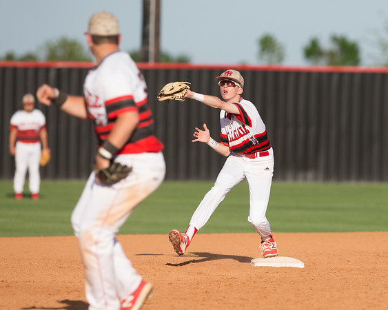 Phoenix special photo by Von Castor<br /> Hilldale's second baseman Kaden Bass takes a throw from Cody Walker to get a force out Monday afternoon against NOAH.