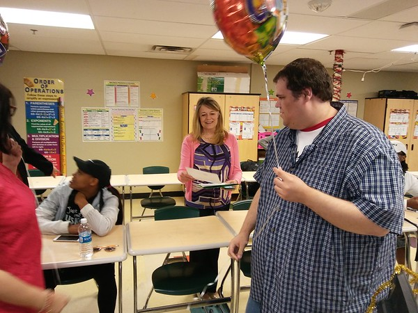 Staff photo by Wendy Burton<br /> Muskogee High School teacher Blane Burge, right, is surprised by the Education Foundation of Muskogee on Monday with a grant to help him prepare his pre-calculus students for the AP test next year.