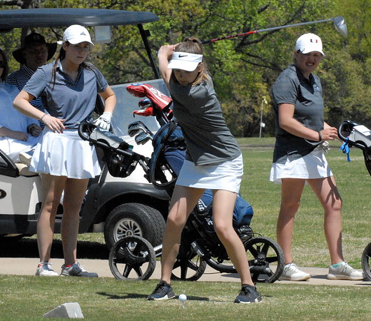 MIKE KAYS/ Phoenix Staff Photo<br /> Kaylee Bryson tees off while watched by members of her group on the 18th hole in Tuesday's Class 6A regional at Muskogee Golf Club.
