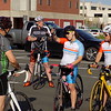 MIKE ELSWICK/Muskogee Phoenix<br /> Esthela Sofia Casale, second from right, gestures Tuesday evening as a group of cyclers prepares to head out from a parking lot off South Third Street. Next to her on the right is her mother, Blanca Casale, who regularly rides too.
