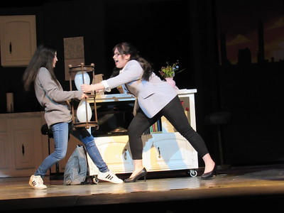 "CATHY SPAULDING/Muskogee Phoenix Daughter Ellie (Alexandria McBrien, left) and mother Katherine (Mattie Hurlburt) wrestle for an hourglass. Their fight has upsetting consequences in the Hilldale School musical ""Freaky Friday."""