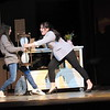 "CATHY SPAULDING/Muskogee Phoenix<br /> Daughter Ellie (Alexandria McBrien, left) and mother Katherine (Mattie Hurlburt) wrestle for an hourglass. Their fight has upsetting consequences in the Hilldale School musical ""Freaky Friday."""