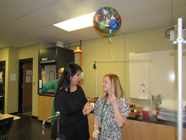 CATHY SPAULDING/Muskogee Phoenix<br /> Education Foundation of Muskogee grant chairwoman Shelly Chitwood, left, visits with Muskogee High School biomedical teacher Carrie Cotten after presenting Cotten with a balloon and a $2,800 grant.