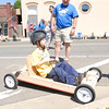 Staff photo by Cathy Spaulding<br /> Ryan-James Butts of Cub Scout Pack 730 tests the pack's entry in the Indian Nations Council Boy Scouts of America Cubmobile Races while den leader Michael Morgan explains how their Cubmobile differs from others.