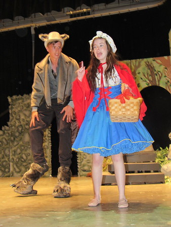 "CATHY SPAULDING/Muskogee Phoenix<br /> Little Red Riding Hood (Haley Richardson), tries talking her way out of trouble with the Wolf (Dwight Chapin) in the Hilldale School musical, ""Into the Woods."""