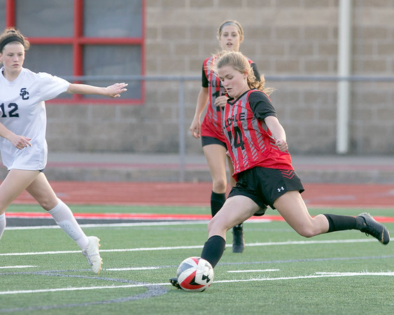 VON CASTOR/Special to the Phoenix<br /> Hilldale's Bella McWilliams score in the first minute of the match against Summit Christian Thursday night at Hornet Field.