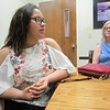 CATHY SPAULDING/Muskogee Phoenix<br /> Jolie Moore, left, and her mother, Tiffany Miller, discuss progress Moore has made at Oklahoma Connections Academy, an online public school.