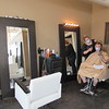 "CATHY SPAULDING/Muskogee Phoenix<br /> Dolce Salon owner Tracy Scott, standing, and customer Cimarron Nichols wear masks during a styling appointment on Friday. Hair salons and other ""personal care"" businesses were allowed to open by appointment only on Friday. Businesses must heed strict sanitation and social distancing rules."