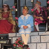 "Staff photo by Cathy Spaulding<br /> Prince Dauntless (Ethan Burk, center) waits on an appropriate suitor while domineering mother Queen Aggravain (Mattie Hurlburt) and King Sextimus (Haven Gulley) watch. Hilldale High School tells the tale<br /> in the musical ""Once Upon a Mattress."""