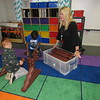 """CATHY SPAULDING/Muskogee Phoenix<br /> Sadler Arts Academy Principal Ronia Davison watches Cody Jack, left, and Taj Smith build with large Lincoln Logs in the school's DaVinci Design Space. Innovative ideas and commitment to """"caring for the whole child"""" helped Davison receive a Medal for Excellence from the Oklahoma Foundation for Excellence."""