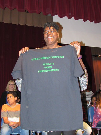 CATHY SPAULDING/Muskogee Phoenix<br /> Sharica Cole holds up a T-shirt naming her as 2018 Muskogee Public Schools Teacher of the Year. Cole received the honor Thursday afternoon at Ben Franklin STEM Academy, where Cole teaches sixth grade.
