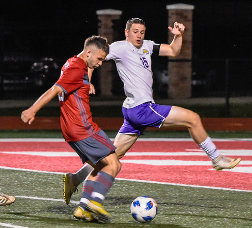 CHRIS CUMMINGS/Special to the Phoenix<br /> Fort Gibson's Rylee Davis kicks a goal past Muldrow's T.J. Evans in playoff action Friday.