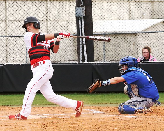 Phoenix special photo by John Hasler Hilldale's Dee Folsom cranks out a three-run home run during the Hornets' 15-0 win over Tulsa Webster which clinched the bi-district series on Thursday. Hilldale won the first game 17-2.