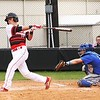 Phoenix special photo by John Hasler<br /> Hilldale's Dee Folsom cranks out a three-run home run during the Hornets' 15-0 win over Tulsa Webster which clinched the bi-district series on Thursday. Hilldale won the first game 17-2.
