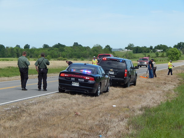 Staff photo by Wendy Burton<br /> A Oklahoma Highway Patrol troopers investigate the scene where a Warner woman was killed and two others injured in a head-on wreck Thursday.