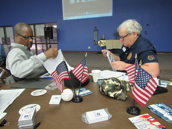 Staff photo by Cathy Spaulding<br /> The Rev. Gary Mitchum, left, pastor of New Zion Baptist Church, and Art Corrales, chaplain of the Wagoner American Legion, review material about dealing with veterans emotional, mental and physical issues. The two attended a session, Military Culture and the Wounds of War.
