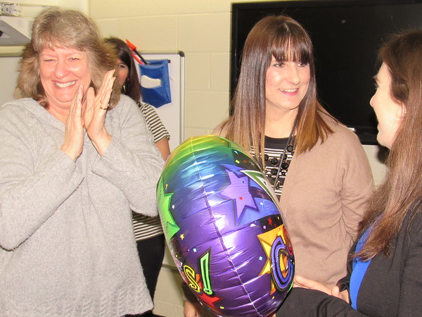 CATHY SPAULDING/Muskogee Phoenix<br /> Pershing Elementary Indian Education Coordinator Sally Daniels, left, applauds while Pershing Librarian Mandi Moore, center and Micah Spena receive a $2,000 Education Foundation of Muskogee Grant to buy books with music.