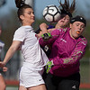 VON CASTOR/Phoenix Special Photo<br /> Fort Gibson's Brooke Hatchette battles the Mannford goalkeeper and a defender for a corner kick Friday in a 4A playoff game at Fort Gibson.
