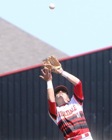JOHN HASLER/Phoenix Special Photo<br /> Hilldale shortstop Dee Folsom flags down a pop-up in the Hornets' game-one win over Catoosa. The Hornets won 14-4, then won 10-4 to sweep the Indians and advance to next week's regional round.