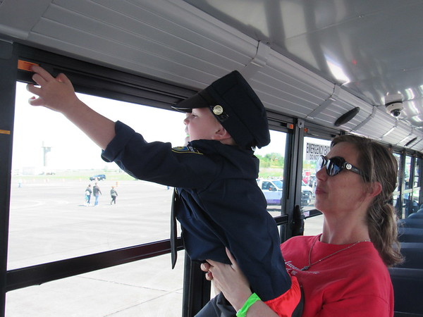 Michelle Morgan holds her 3-year-old grandson<br /> Grayson Fox Girty as he opens a Hilldale school bus<br /> window.