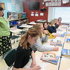CATHY SPAULDING/Muskogee Phoenix<br /> Diane Walker poses tough questions in a recent Advanced Placement world history class at Muskogee High School.