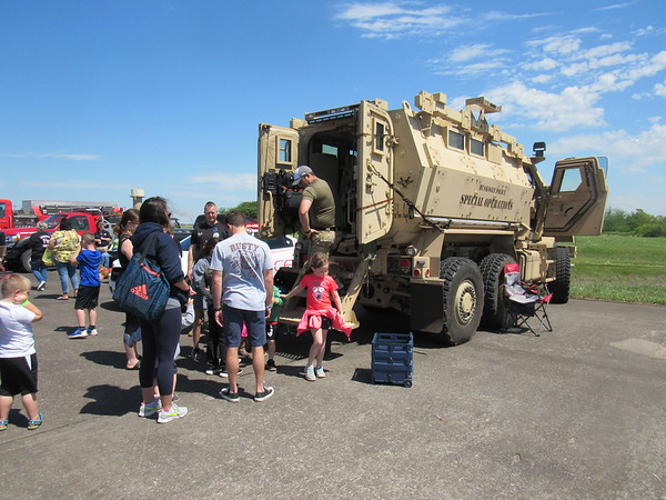 Youngsters line up to check inside a Muskogee Police Department Mine-Resistant Ambush Protected vehicle.