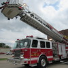 Staff photo by Cathy Spaulding<br /> Muskogee firefighter Matt Goodmiller lowers a ladder on Muskogee Fire Department's Ladder 1 truck. The truck will be rolled out Saturday for Touch-A-Truck at Davis Field.